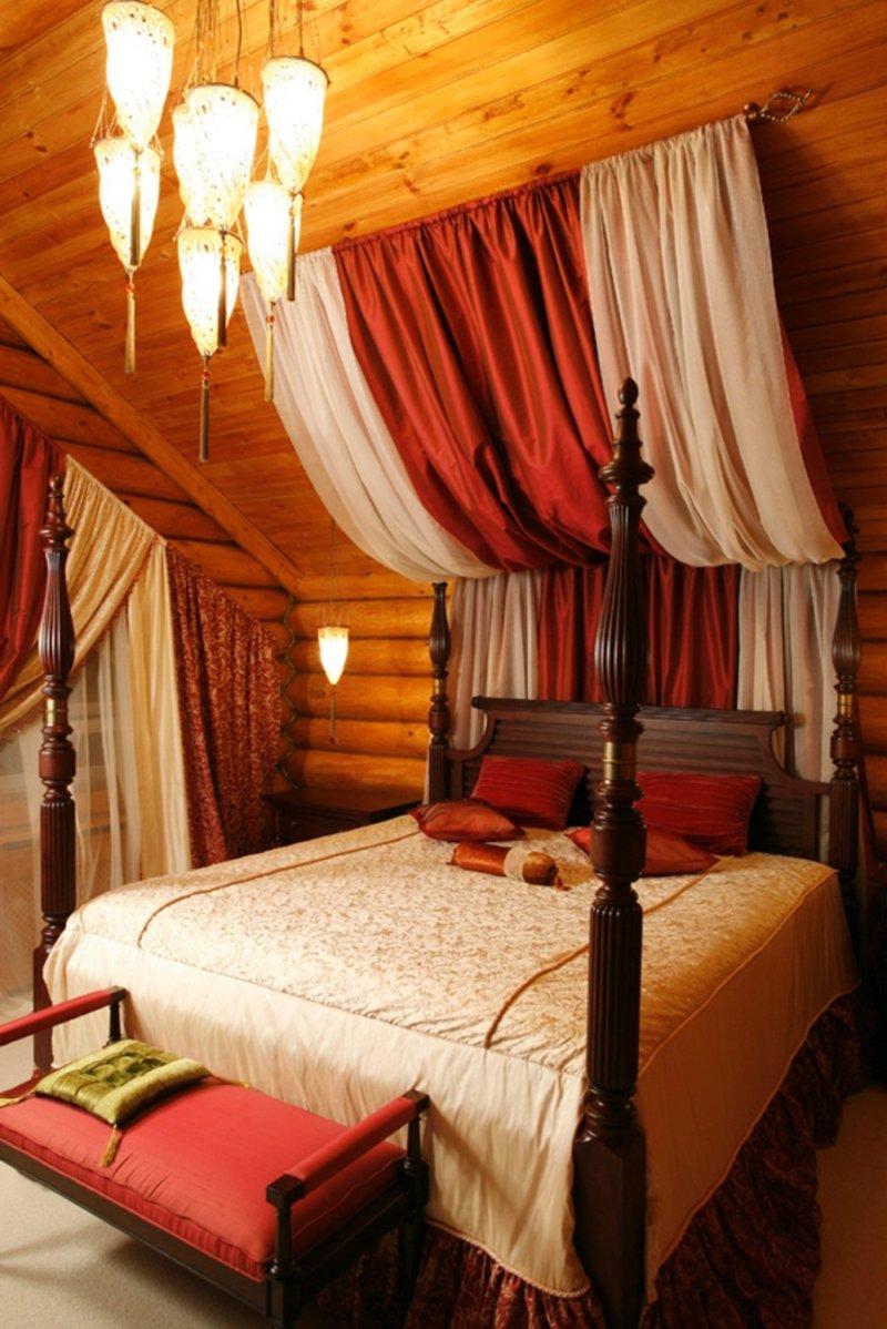 Бордовый цвет на мансарде в спаоьне