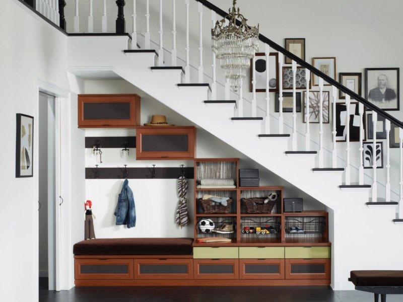 Современные шкафы в гостиную 33 фото навесные модели для одежды в современном стиле для различных комнат